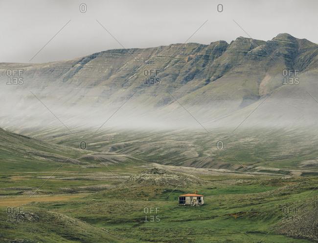 Lone hut in valley, Mosfellsheidi, Iceland