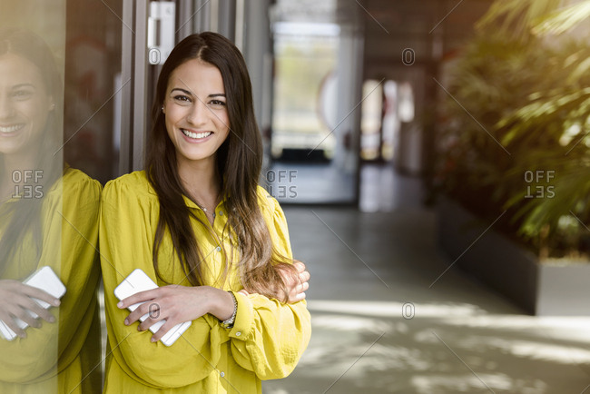 Portrait of young businesswoman in office atrium