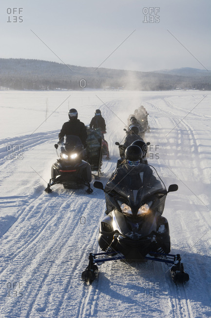 Group of people on snowmobiles, Jukkasjarvi, Sweden