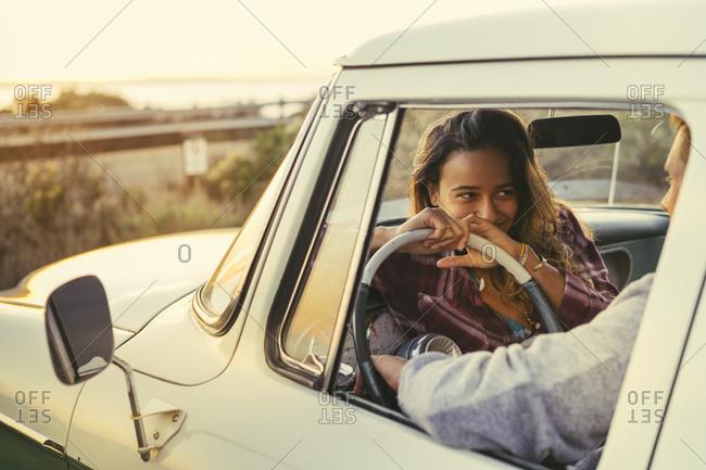 Romantic couple in pickup truck at Newport Beach, California, USA