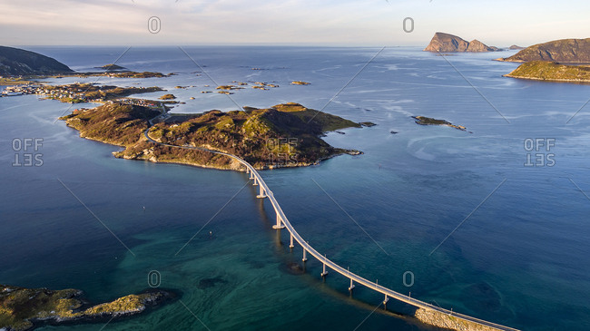 Aerial view of famous Sommaroy Bridge crossing from Kvaloya Island to Sommaroy Island in autumn, Arctic Norway