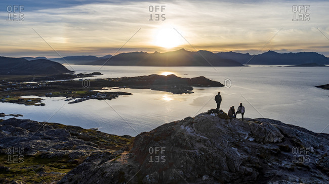 Aerial view of group of people climbing a summit on Kvaloya Island in autumn, Arctic Norway