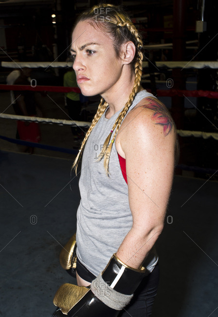 Aggressive female boxer in boxing ring
