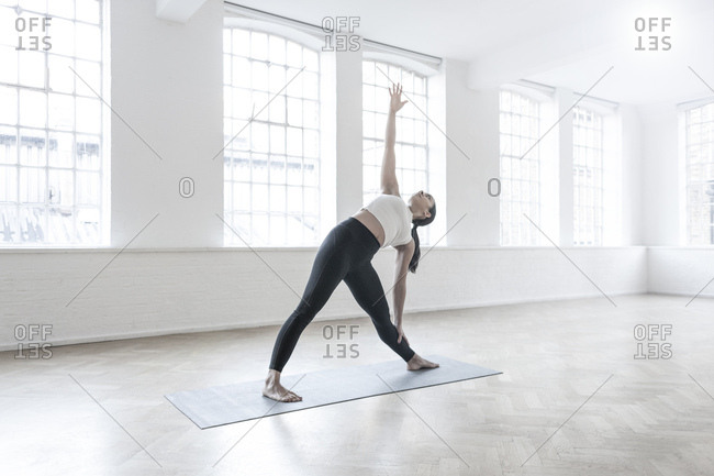 Woman in dance studio stretching