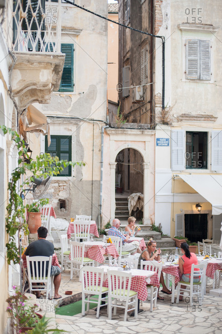 September 25, 2016 - Corfu, Greece: People dining at outdoor cafe