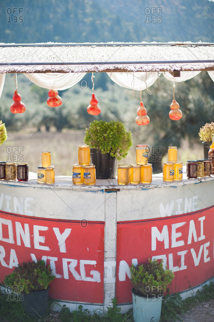 September 30, 2016 - Lefkada, Greece: Roadside stand selling jars of honey