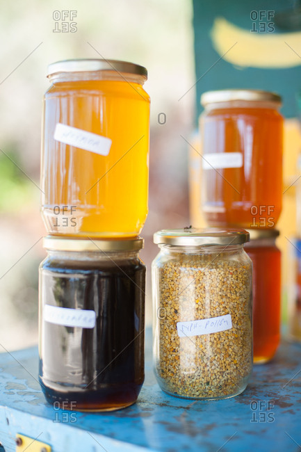 Honey and bee pollen for sale at beekeeper's stall