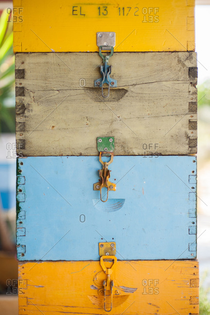 Stack of colorful wooden bee hive boxes