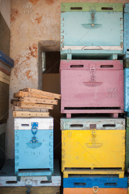 Honeycomb frames stacked on wooden bee boxes