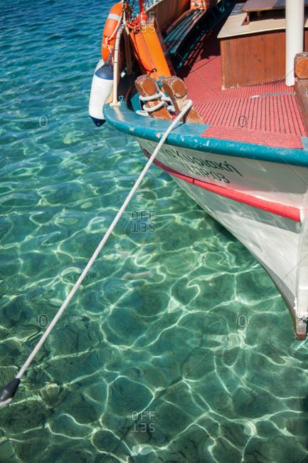 October 1, 2016 - Kefalonia, Greece: Rope off bow of boat docked in Fiskardo