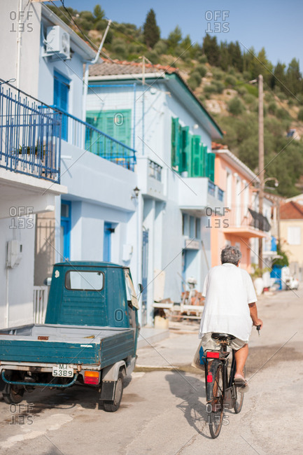 October 3, 2016 - Ithaca, Greece: Man riding bicycle in Vathy