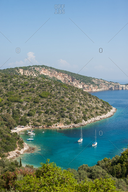 Hillside and boats at beach on Ithaca, Greece