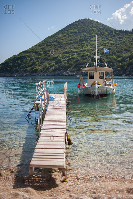 Fishing boat parked next to floating dock on Ithaca, Greece