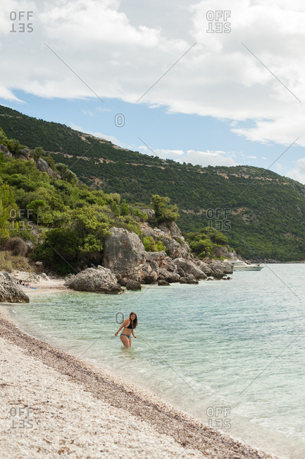 October 5, 2016 - Ithaca, Greece: Girl going for a swim at Agios Ioannis beach