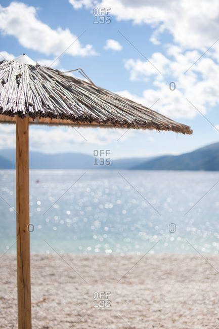 Thatched umbrella on beach in the Ionian Islands, Greece