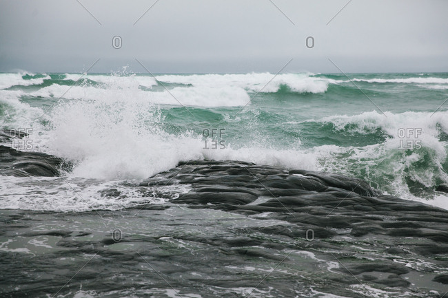 Waves rolling in on rocky coastline