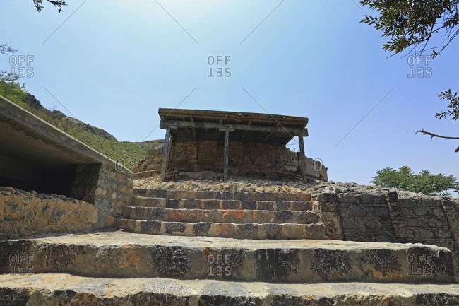 Stone steps and shelter at the ruins of the Mohra Moradu monastery near Taxila, Pakistan