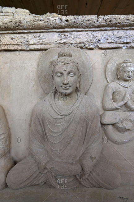 Figures of Buddha carved into stone at the ruins of Jaulian monastery, Taxila, Pakistan