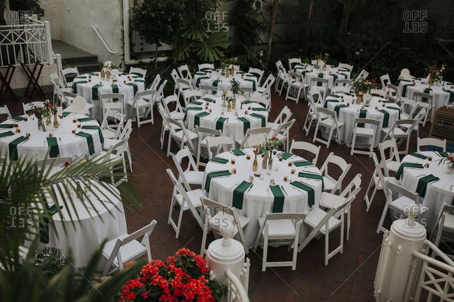 Tables decorated for a wedding reception in a conservatory