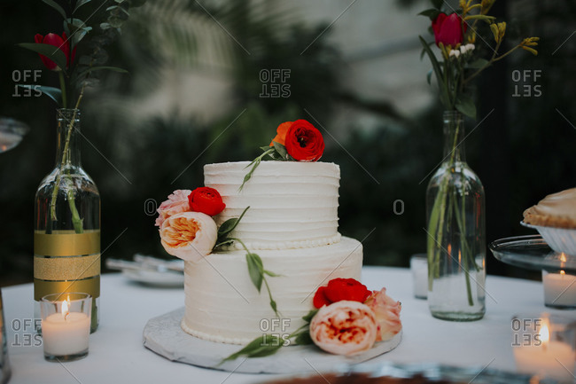 Simple Two Tiered Wedding Cake Decorated With Pink And Red Roses