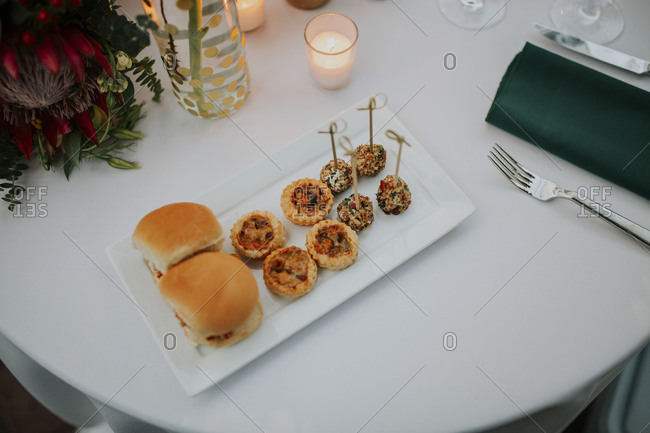 Variety of appetizer on a white plate on a reception table