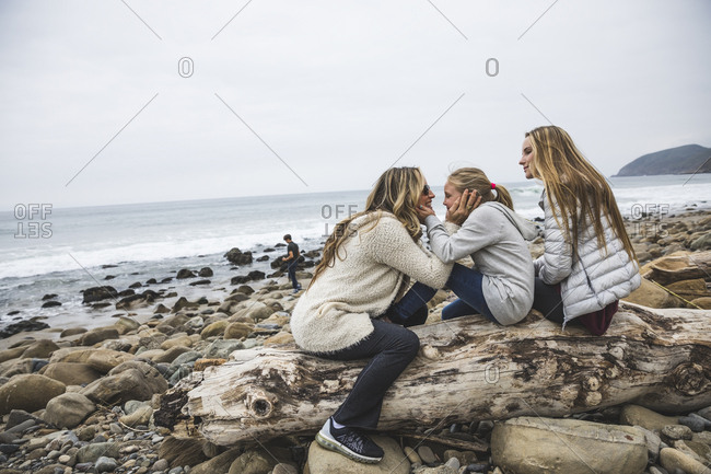 Mother and daughters at the beach
