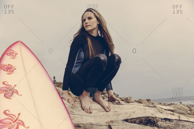 Portrait of teenage girl in wetsuit on the beach