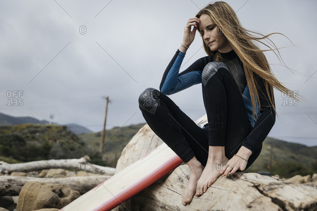 Teenage girl with surfboard at the beach
