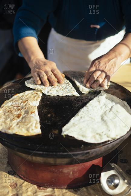 A woman making Lavash Bread in Baku, Azerbaijan