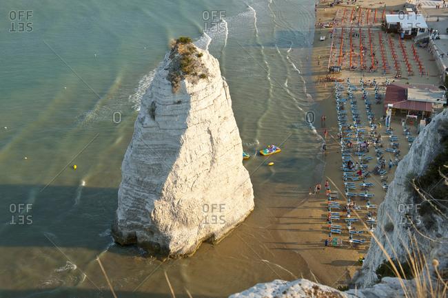 Italy, Apulia, Vieste. Gargano - Faraglione along Pizzomunno beach