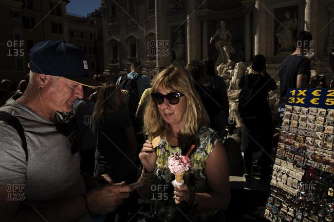 5/3/17: Tourist holding an ice cream cone near Fontana di Trevi in Rome, Italy