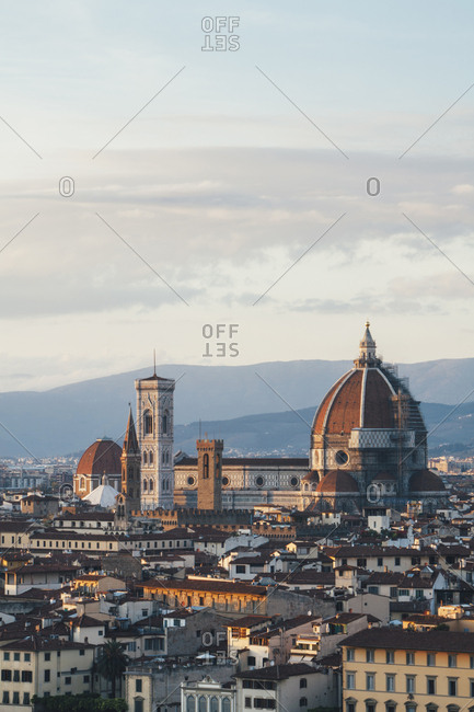 The Duomo, the roof of the cathedral and historical landmarks of Florence city seen from a height.