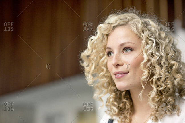Portrait of smiling blond businesswoman with ringlets