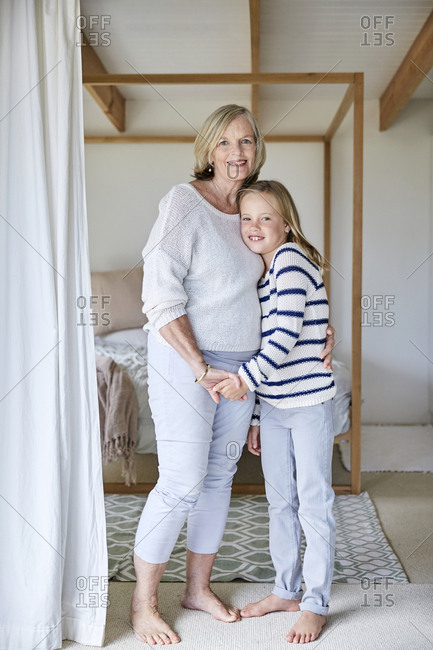 Portrait of little girl with her grandmother  at home