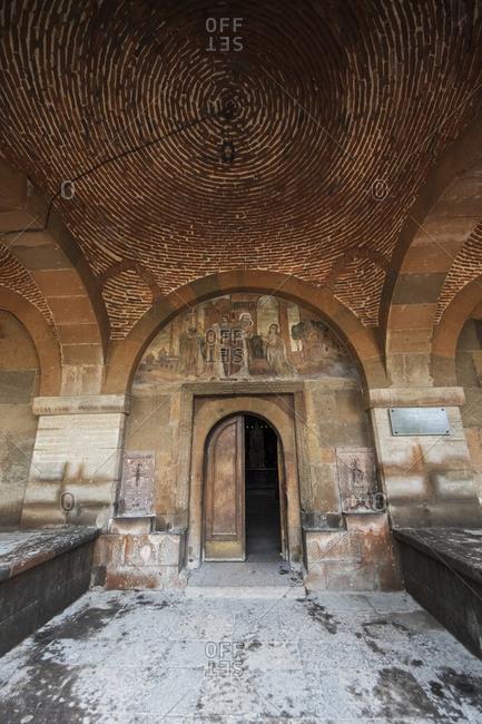 Vagharshapat, Armavir Province, Armenia - May 9, 2017: Frescoes depicting saints on the tympanum above the door to Saint Gayane Church, Vagharshapat