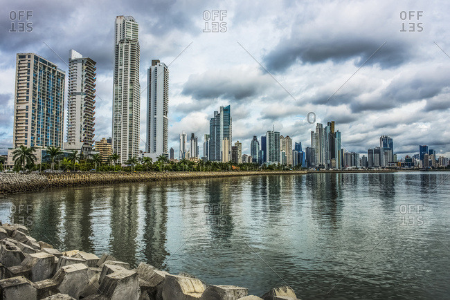 Panama City, Panama - May 9, 2017: A portion of the Panama City skyline at Cinta Costera area as seen from the coastal trail near the Casco Veijo