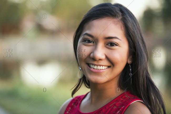 Portrait of a beautiful young Filipino woman smiling in a city park in autumn, St. Albert, Alberta, Canada