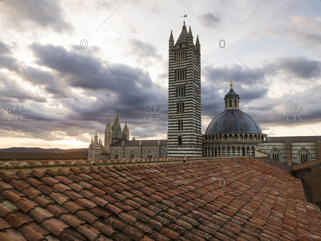 Siena Cathedral's tower with striped facade and dome roof, Siena, Italy