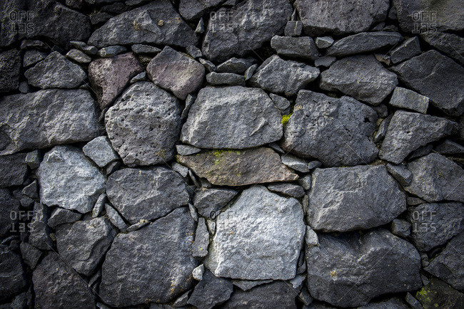 Basalt rocks wall in Lagoa das Furnas park, Furnas, Sao Miguel, Azores, Portugal