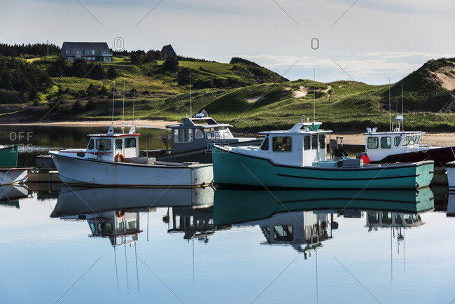 Fishing boats in the tranquil harbor, Mabou, Nova Scotia, Canada