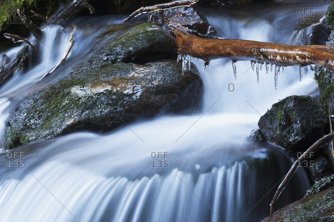 Waterfall with ice in the rainforest along the Herring Cove trail, near Sitka, Alaska, United States of America