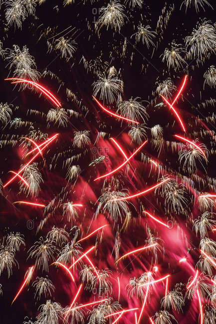 Red and white fireworks in night sky, Quebec, Canada
