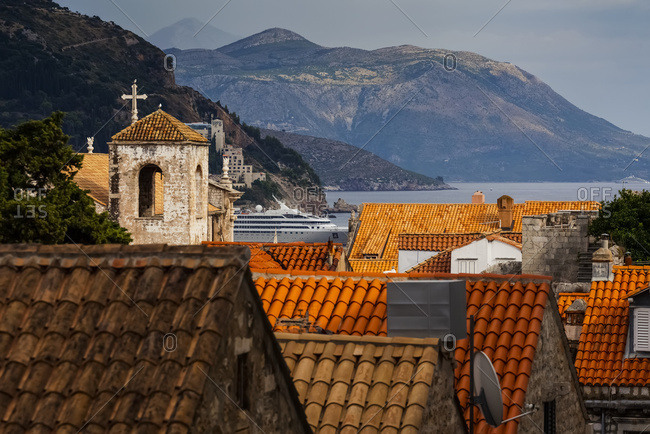 View of rooftops, a tower with a cross and the coastline, Dubrovnik, Croatia