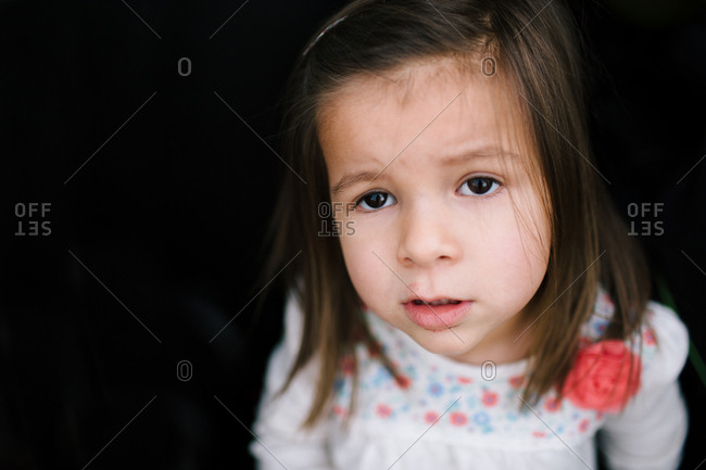 Close up portrait of young girl with a questioning expression