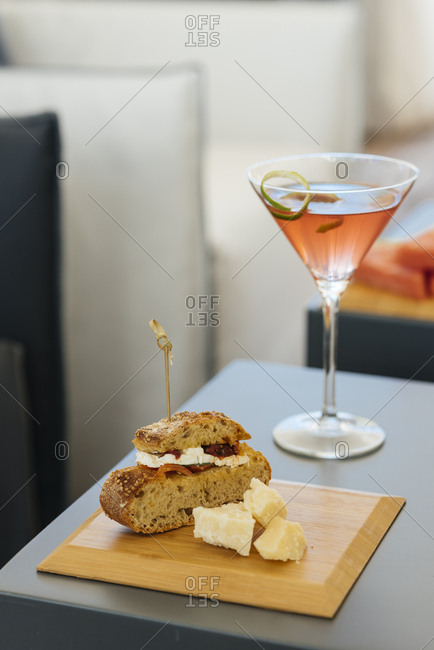 Cocktail and sandwich on table