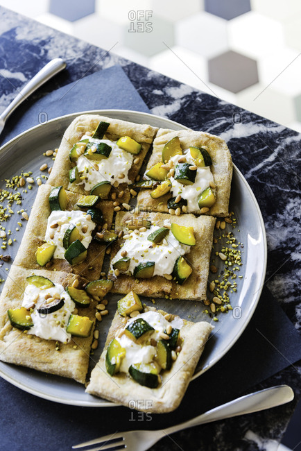 Pizza flatbread with cheese and zucchini