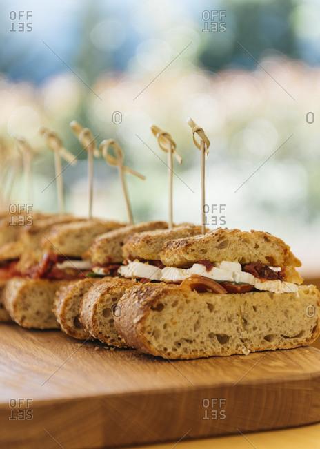 Slices of Sicilian sandwich on wooden cutting board