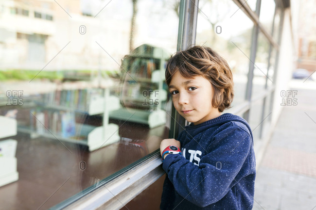 Boy leaning against a window