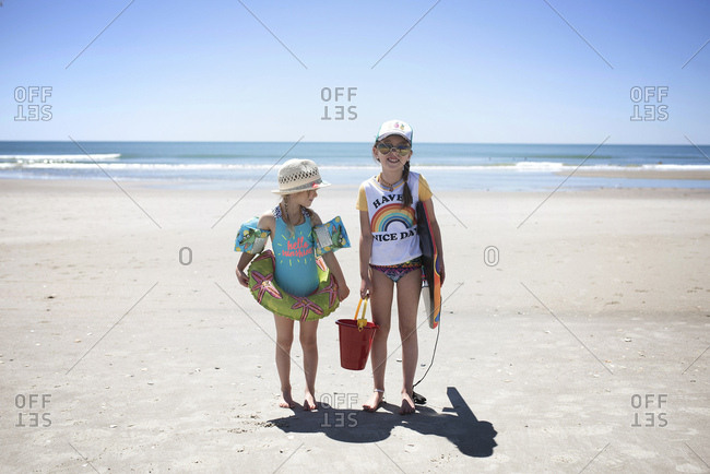 Two young sisters at the beach