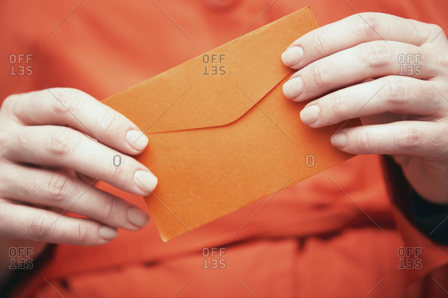 Woman holding envelop with letter